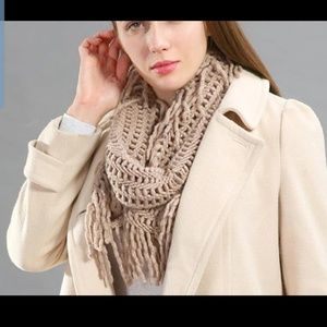 Soft infinity scarf with fringe.